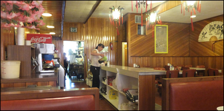 Photo Hilander Restaurant Features A Very Comfortable Dining Room My Friendly Server Pours Ice Tea From Behind The Small Counter And Open Door